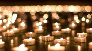 detailed-shot-of-burning-candles-in-the-church_bgqbhc24__S0000